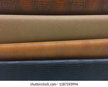 Four different colors and textures of vinyl