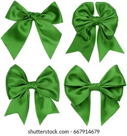 Four different green gift satin bows with tails on a white background