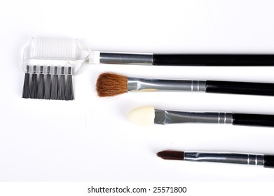 Four different make up brushes over white background