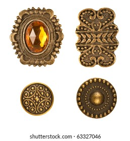 Four different medieval bronze buttons arraged on white