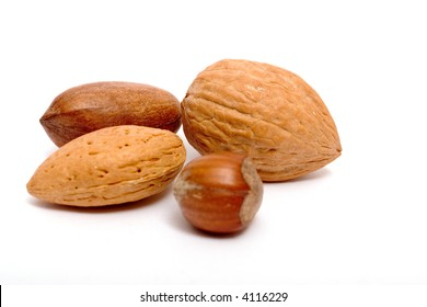 four different nuts, isolated on white