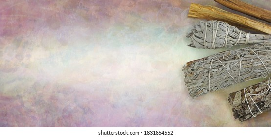Four different smudge sticks website message banner background - rustic stone effect pale background with copy space for smudging text on left and  white, blue sage sticks and Yerba Sante on right