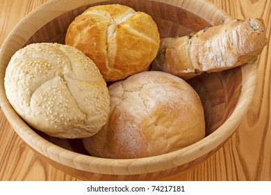 Four different types of bread in a wooden cup
