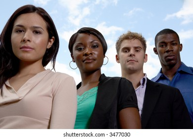 four diverse members looking at camera
