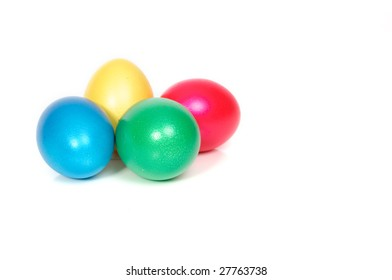 four easter eggs, yellow, blue, green, red