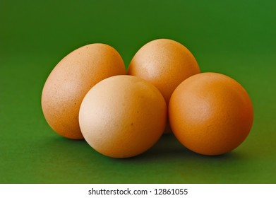 four eggs with a green background