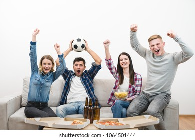The four emotional friends on the sofa watch a football on the white background