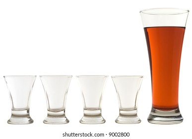 four empty shots and one full beer glass