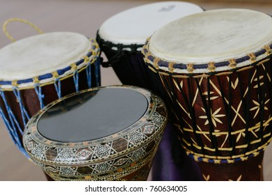 Four ethno drums indoors. Close-up view. Darbuka and djembe.