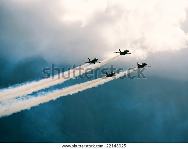 Four FA-18 jets of the U.S. Navy's precision flight team, the Blue Angels, fly in the skies of Hawaii.