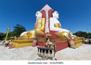 Four Faces of Buddha at Kyaikpun Buddha, in Bago, Myanmar.
