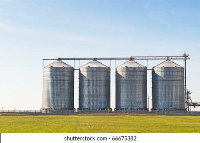 four farm grain silos for agriculture