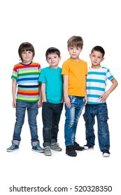Four fashion young boys are standing together on the white background