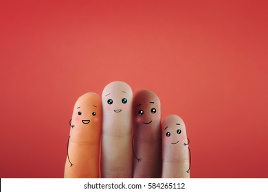 Four fingers decorated as four person with different skin color.Suitable for anything against racism.