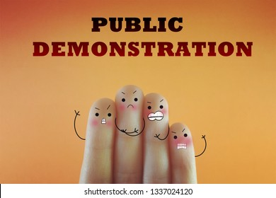 Four fingers decorated as four person. They are angry and dissatisfied about public demonstration.
