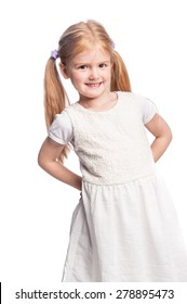 Four five year year old girl smiling in studio portrait.