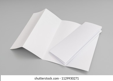 Four- fold white template paper on grey background.