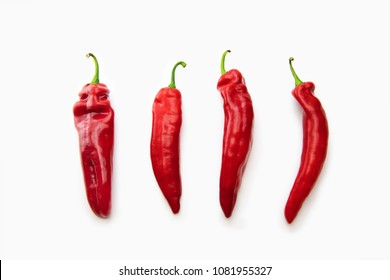 Four Fresh harvested sweet pointed peppers, isolated on white.Each are approx. 20cm in length.