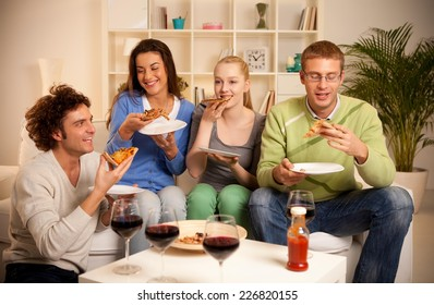 Four friends having dinner at home.