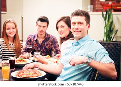 Four Friends Having Lunch At A Restaurant
