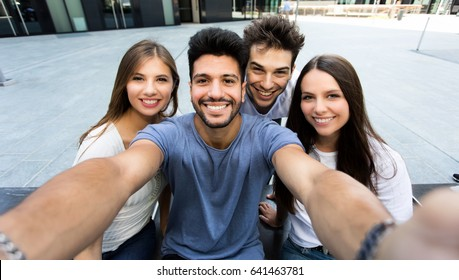 Four friends taking a selfie together