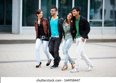 four friends walking together through the city