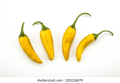 four fruits of golden fresh chilli pepper on a white background still life top view