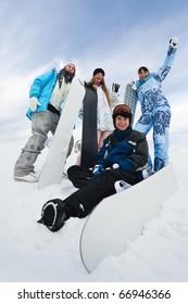 Four fun snowborders in mouintain