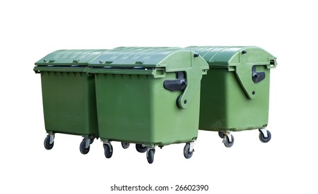 Four garbage containers. Green four wheeled trash cans isolated