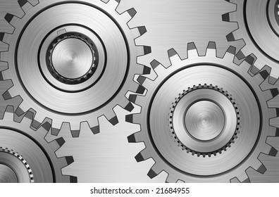 Four gears on steel background