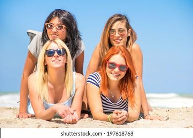 Four girls having fun on the beach