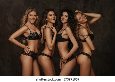 Four girls in lingerie at dark background