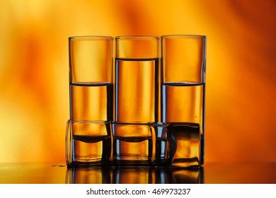 four glasses of water on the fire background three are one lies