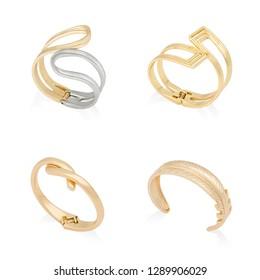 Four golden bracelets isolated on white background