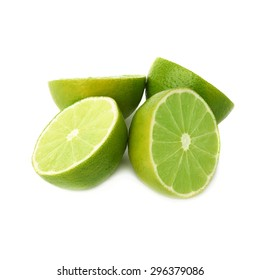 Four halves of a green lime fruit isolated over the white background