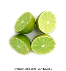 Four halves of a lime fruit isolated over the white background, top view