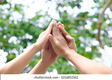 Four hand up of people working assemble corporate meeting show symbol Join forces teamwork quality and effective personnel Concept organizational development in teamwork and business