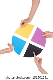 Four Hands Holding Colorful Pieces of a Chromatic Circle, Isolated