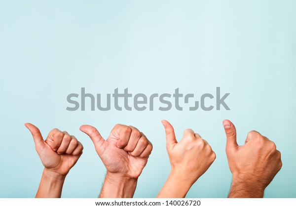 Four hands making like, recommend, success gesture with thumbs up. Content marketing satisfaction concept. Native advertising. Influencer marketing concept