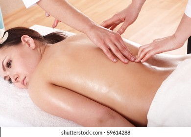 Four hands massage in beauty parlour.