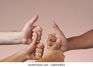 Four hands with thumbs-up isolated. Diversity and inclusive concept.