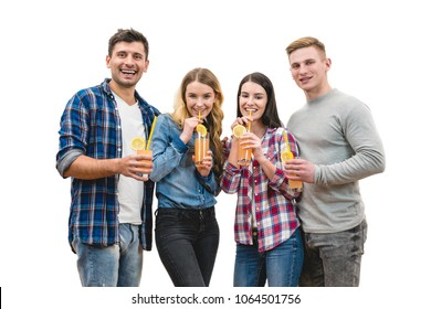 The four happy friends drink cocktails on a white background