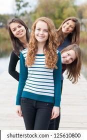 Four happy teenage girls friends