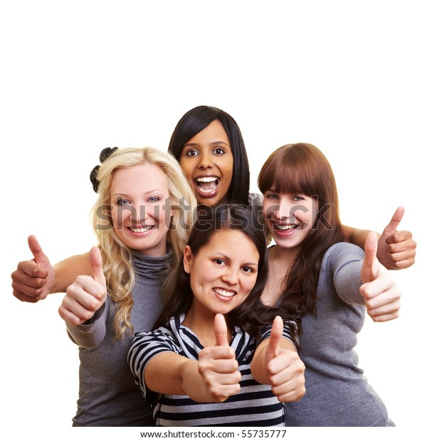 Four happy young women holding their thumbs up