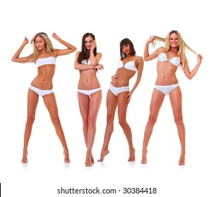 Four harmonous suntanned young women in full growth, in white underwear, isolated on a white background, please see some of my other parts of a images