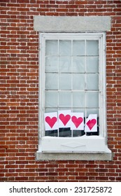 Four hearts in a window bring cheer to a cold winter day.