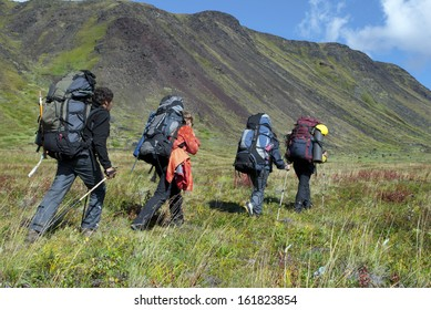 four hikers in the mountains