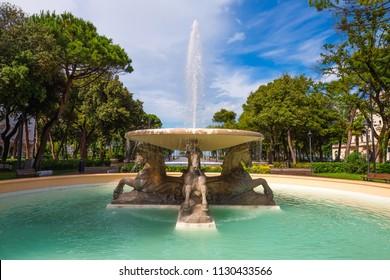 Four horses fountain in Rimini on a sunny day. Landmark of Rimini. Italy.