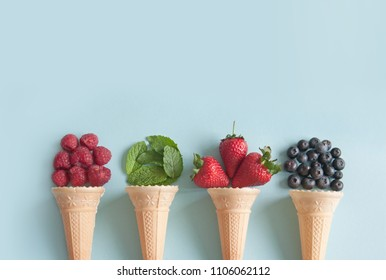 Four icecream cones with natural ingredients including berries, and mint flavors