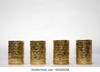 Four identical height of the stack of coins on a light background, the top place for an inscription